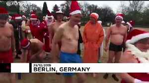Berlin swimmers take the plunge for Christmas [Video]