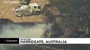 Australian firefighters tackle bushfires on Christmas Day as temperatures ease [Video]