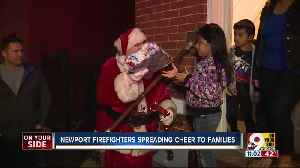 Newport firefighters spread cheer, deliver gifts to five families [Video]