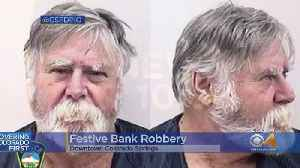 News video: Suspect Accused Of Robbing Bank, Throwing Money & Saying 'Merry Christmas'