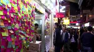 News video: HK protesters gather for free Christmas dinner
