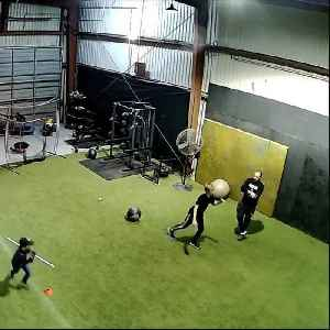 Kid Practicing Throwing Ball Against Wall Hits Coach in Crotch [Video]
