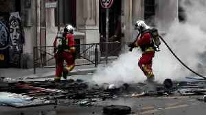 Firefighters put out blaze in central Paris after another day of protests [Video]