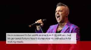 Robbie Williams: I still love working [Video]