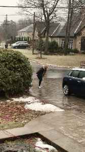 Teamwork Helps Navigate Super Slippery Driveway [Video]