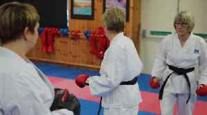 Pensioners become two of the oldest people to achieve black belts in karate [Video]