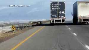 Amazon delivery truck swerves off interstate in high winds [Video]