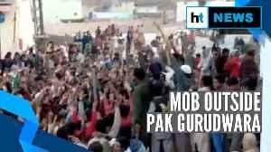 News video: Watch: Mob surrounds, threatens to occupy Nankana Sahib Gurudwara in Pak