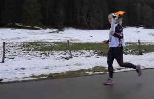 Olympic flame crosses Swiss-French border [Video]