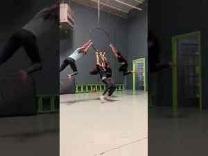 Girl Spinning on Hanging Hoop Falls to Floor [Video]