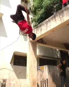 Guy Amazingly Does Castaway Backflip While Hanging From Roof's Edge [Video]