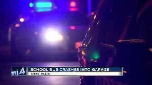 News video: School bus with children on board crashes into a West Allis garage