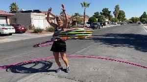 Largest Hula Hoop Spun by Woman Hula Hooper [Video]