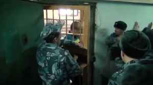 Russian Prison Guards Filmed Punching Inmates [Video]