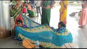 Pregnant woman on her way to hospital has to give birth at bus stand with help from nearby women [Video]