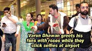 Varun Dhawan greets his fans with roses while they click selfies at airport [Video]