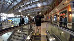 Londoners travel on the Underground on 'No Trousers Tube Ride' day [Video]