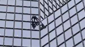 'French Spiderman' scales skyscraper in support of pension strikers [Video]