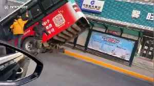 News video: Nine people killed after sinkhole swallows bus while passengers were boarding in China