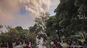 Wedding goes ahead despite erupting volcano [Video]