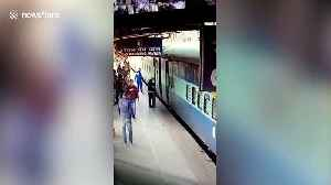 Alert railway guards save elderly man who fell while boarding moving train in eastern India [Video]