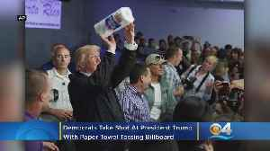 Democrats Take Shot At Trump With Paper Towel Tossing Billboard [Video]