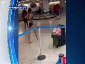 WEB EXTRA: Naked Woman Walks Through Miami International Airport [Video]