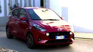 The new Hyundai i10 in Dragon Red Driving in the city [Video]