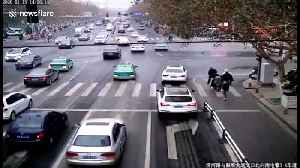 Chinese man walks along guardrails on busy road to check his blood pressure [Video]