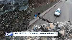 Residents call for repairs to old train bridge before someone  gets hurt [Video]