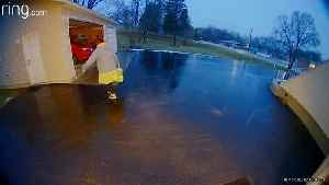 Woman's Surprise Sip on Icy Driveway [Video]