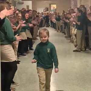 This little boy was greeted with a standing ovation when he returned to school after his last round of chemo [Video]
