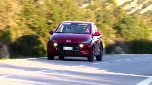The new Hyundai i10 in Dragon Red Driving in the country [Video]