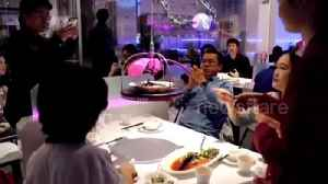 China's first fully automatic restaurant launches with robot staff [Video]