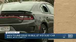 A man found dead in a bullet-riddled car [Video]