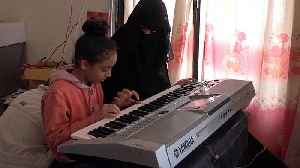How is a Yemeni school using music to help children in wartime? [Video]