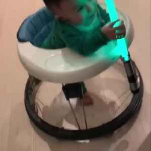 Toddler Runs Around in His Walker Holding Toy Sword in Hand [Video]