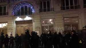 Scores of protesters gather outside theatre attended by Macron [Video]