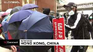 News video: Rally cut short in Hong Kong as police confront protesters