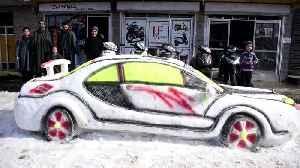 Boy make impressive sports car out of snow [Video]