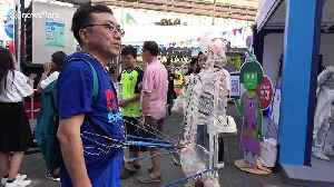 Japanese inventor shows off dancing skeleton suit at Thai tech convention [Video]