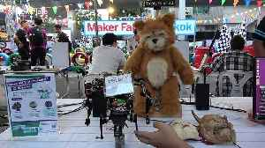 Artificial Intelligence Teddy Bear controlled by robot on display at Thai tech convention [Video]