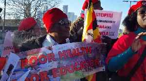 Ugandans protest against country's government outside UK-Africa business summit venue in London [Video]