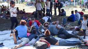 News video: Migrant group camps at Guatemala-Mexico border in bid to reach US