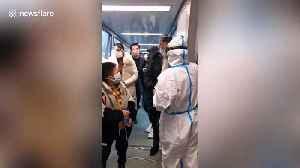 Hangzhou International Airport staff check tourists' temperatures amid coronavirus scare [Video]