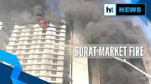Watch: Firefighters continue to battle Surat market blaze [Video]