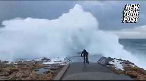 Cyclist has epic wipeout when gigantic wave crashes into pier [Video]
