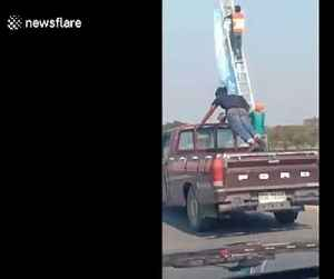 Reckless passenger does press-ups in the back of moving pickup truck in Thailand [Video]