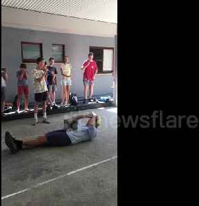 Australian science teacher performs controversial psychics experiment letting student smash concrete block on his chest with sle [Video]