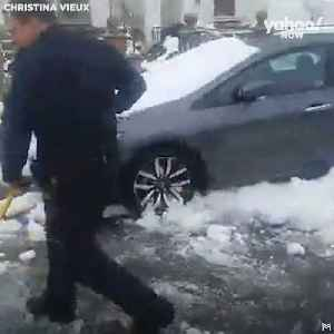 News video: These New York City Police Officers help a Woman shovel her car out of Snow Pile